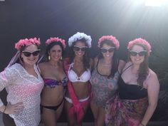Bachelorette party matching flower veils and jewel glasses.