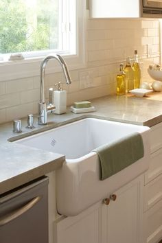 love the light gray counter tops and farm sink