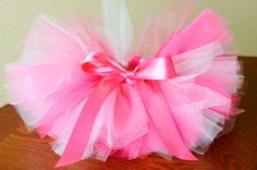 Becoming obsessed with tutus and bows already, won't find out for at least one month if baby is a girl or boy.