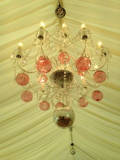 Chandeliers sparkle from the ceiling Chandeliers, Sparkle, Ceiling Lights, Weddings, Home Decor, Transitional Chandeliers, Homemade Home Decor, Chandelier, Ceiling Light Fixtures