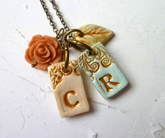 Personalized letter necklace $34.00.  Would be neat for kids initials or a couple's initials.  <3