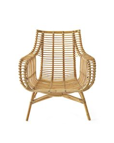 It's casual, it's coastal, it's unexpected...With its good looks and excellent craftsmanship, this is everything we love in a chair. The rattan frame – steamed and bent into shape by hand – is accented with hand-wrapped rawhide around the joints and can be used with or without a cushion. A low-seat profile completes the relaxed vibe.