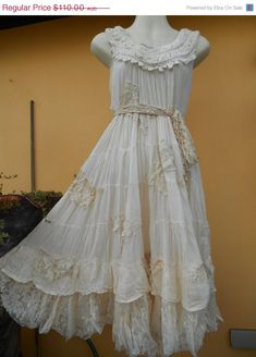 shes a wonderful shabby chic bohemian dress with ruffles of lace,shabby crochet motifs and roses....and crushed my style.. smocked and tiered she has