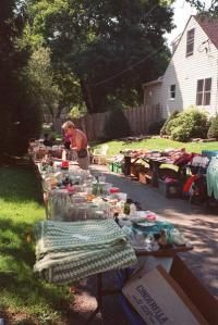 A bargain hunter browses tables of secondhand merchandise at the townwide yard sale in Lebanon, N.J.