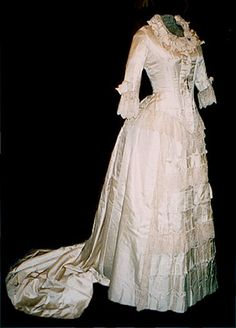 """*What if this had a sheer toille over-skirt? with a sheer train with lace applied around the hem?* This Victorian wedding dress reflects the fashions of the mid-to-late 1870s. In 1878, a similar design gown was featured in Harper's Bazaar as a """"Bridal Toilette."""