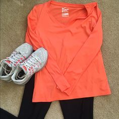 Coral NIKE TEE. Barely worn Get your workout on in the awesome, sweat wicking NIKE TEE!! Nike Tops Tees - Long Sleeve