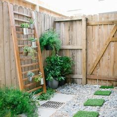 Urban Backyard Decorating Ideas: A stair banister becomes a DIY succulent wall. And check out the artificial grass stepping stones! We love the gorgeous outdoor space styled by Ashley Rose of Sugar and Cloth. Large Backyard Landscaping, Small Backyard Gardens, Backyard Garden Design, Diy Garden, Outdoor Gardens, Backyard Ideas, Modern Backyard, Patio Ideas, Garden Pallet