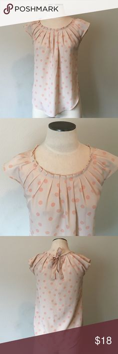 LC Lauren Conrad-Pink Dot Pleated Neck Blouse XS LC Lauren Conrad- Pink Pleated Neck Blouse. Beautiful light pink with a darker pink polka dot print. Back has a keyhole tie detail. Great condition. 100% polyester.Size XS LC Lauren Conrad Tops Blouses