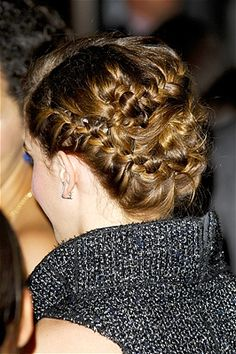 """Emma Watson stunned on the red carpet for the Los Angeles premiere of """"The Bling Ring"""" with a chic braided updo."""