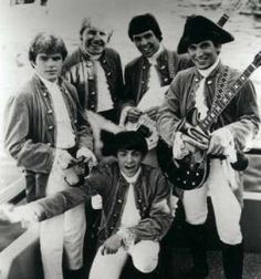 Paul Revere and The Raiders 1960s (happy, upbeat music) My favorite group!