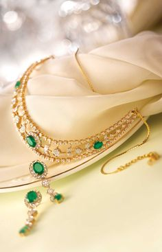 One of the first considerations when acquiring a diamond pendant is the size of the diamond. Diamonds are measured in carats with a larger number indicating a larger and more costly stone. Emerald Jewelry, Gold Jewelry, Jewelery, Women Jewelry, Diamond Jewellery, Tanishq Jewellery, Emerald Necklace, Jewelry Sets, Diamond Necklace Simple
