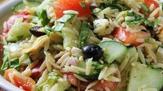 Greek Orzo Salad | Orzo pasta is tossed with artichoke hearts, cucumber, feta, tomato, olives and a zesty dressing. #orzo #salad #greek