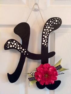 super cute letter door decoration, wreath substitue--@Meghan Krane Barone add sparkle and little mirror sequins!!!