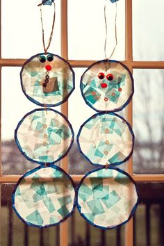 Cute winter craft for kids--stained glass snowmen. #snowmen #winter
