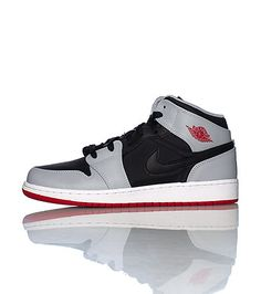 check out 1ee3f 3b787 JORDAN Mid top kid s sneaker Lace up closure Padded tongue with JORDAN logo  Signature affiliate NIKE swoosh on sides of shoe Cushioned sole for comfort