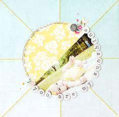 you are my sunshine - Scrapbook.com - Love this big sun as the center of the layout with 1/2 photo and 1/2 patterned paper.