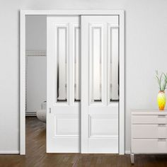 Twin Telescopic Pocket Peony 2L Doors Silkscreen Obscure Glass - Clear Borders.    #whitedoors #glazeddoor #pocketdoors #hiddendoors #telescopicdoors moderndoors #lpddoors #interiordesign #moderniinteriordoors