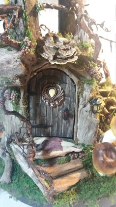 Welcome to my imagination and the miniature world of fairies! Here is my latest creation, Bramblewood. This fairy house is constructed of driftwood, gnarly vines, berries and moss. Preserved fungi shingles the roof. A genuine squirrel skull is mounted on the front of the tower. Perhaps a dark fairy will call this home?  This home measures appx. 22 at tallest and about 14 in diameter with measurements including the wooden turn table base. It is fully lighted and light spills out the grid…