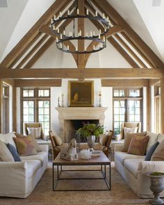 When you need an accent to complement lovely rustic beams, look no further than a simple oversize light fixture. This living room chandelier uses faux candles on two tiers … Home Living Room, Living Room Designs, Chandelier In Living Room, Living Room Light Fixtures, Elegant Living Room, Modern Living, Furniture Placement, Family Room Design, Cheap Home Decor