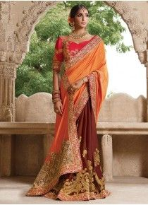 Buy online orange soft net, chiffon and georgette indian bridal saree. This indian bridal saree is prettified with attractive patterns of embroidered and patch border which gives gleaming look.