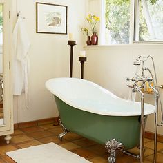 Sink into a tub ― in your own backyard bathhouse - the green, white, and terra-cotta color palette and vintage elements like the claw-foot tub and wardrobe for towels make this room feel like it's  at a country inn.   - photos : Sunset #2