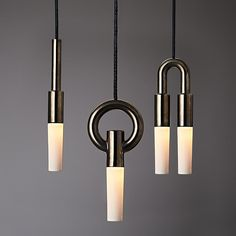 Geometric and distinctive, the I-O-N  is available as a pendant and as a wall sconce. Originally, the I-O-N series was a simple play on geometric forms, there are three form variations in its immediate family.