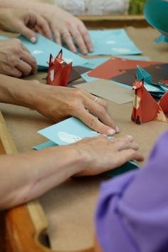 Paper Animals. Watch as baby shower guests create woodland creatures to make into a nursery mobile.