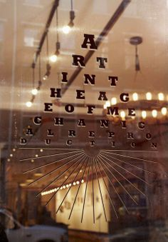 Eye chart logo in the window of Art in the Age in Philadelphia. #visitphilly #phillyaphrochic