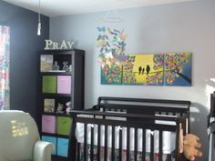 Colorful #nursery using grays, black, and pops of bold colors.  These #color choices will allow the #babyroom to grow with the child. #colorinspires