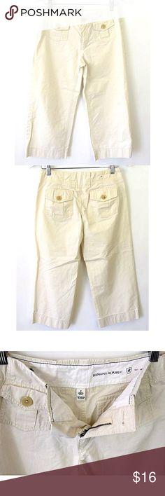 "Banana Republic Khaki Crop Capri Pants Sz 2 Brand: Banana Republic Style: Crop/capri pants   Size: 2   Color/Pattern:Solid khaki tan   Material: 100% cotton   Measurements taken flat:  -Waist: 15"" -Inseam: 22.5"" -Rise: 8.5"" -Leg Opening: 9.5"" Garment Care: machine wash, tumble dry    Condition: No flaws. Banana Republic Pants Capris"