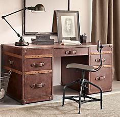 How fun is this desk from Restoration Hardware? They have an entire line of steamer trunk inspired desks and other home office furnishings.