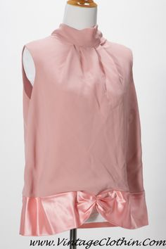 1980s/1990s Sheer Pink and Satin Blouse/Top turtle style neck, darted front, silk satin scalloped bottom edge that is clinched in the middle, internal lining, 3 button fasteners at the back. Has ILGWC Union label from 1974 – 1995.  Size Large, Extra Large  http://shop.vintageclothin.com/1980s-1990s-Sheer-Pink-and-Satin-Blouse-Top-VC1100.htm  $35.00 Plus Shipping #Vintage #Vintageclothin #vintagefashion  #vintageshop #vintageseller #vintagestore  #vintageshopping #forsale #buyme #pink