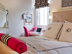 This bedroom in neutrals and pinks is ideal for today's teenage girl. The monogrammed pillows and bedspread along with bold patterns on the roman shades highlight the occupant's individuality.