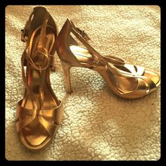 """BRAND NEW BCBG Gold Sandals BRAND NEW NWOT BCBG Gold Sandals - brand new and never worn as seen from the pictures. Bought for a wedding but didn't wind up wearing them. Size 10 and buckle closure. Appx. 5 1/8"""" heel and appx. 3/8"""" platform in front of shoe. Purchased from BCBG website. A beautiful sexy shoe! BCBG Shoes Sandals"""