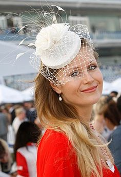 "Lovely white pillbox fascinator. How I wish hats were more ""in"" in the US! They add such an air of mystery. I do believe they are correctly named fascinators. Oh, put me on the Orient Express! Vienna here I come"