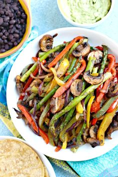 Vegan Fajitas is a Tex-Mex dish consisting of seasoned roasted vegetables served with tortillas. This sheet pan version is healthy and easy to make. Serve them topped with fresh guacamole and black beans on the side for a complete nutritious meal. Vegan Fajita Recipes, Vegan Fajitas, Vegan Dinner Recipes, Veggie Recipes, Whole Food Recipes, Vegetarian Recipes, Healthy Recipes, Vegetarian Fajitas, Recipes