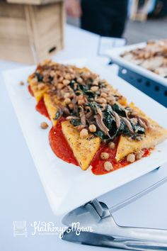 A hearty option for vegetarians or vegans: Seared Sweet Potato Polenta Triangles: with sautéed kale, caramelized onions, & chick peas. Ravishing Radish Catering. Katheryn Moran Photography.