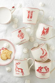 https://www.anthropologie.com/shop/holiday-icon-mug?color=012&quantity=1&size=MUG%2FCUP&type=REGULAR  The cat/dog one