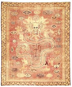 A Chinese rug BB2640 - An exceptional mid 19th century Chinese antique rug, the abrashed light brown field with sparse cloud forms ...