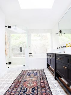 Persian rug in white bathroom