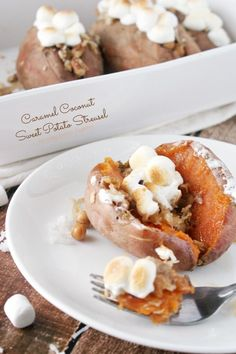 These Caramel Coconut Sweet Potato Streusels are the perfect addition to your Thanksgiving table this year. Sweet brown sugar, crunchy pecans, gooey caramel and coconut stuffed in a sweet potato and topped with mini marshmallows. Your whole family will beg for more!
