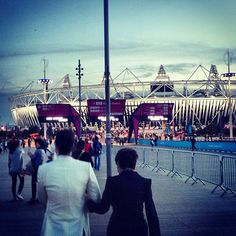 Last night, I was with my son, Sean, for the Closing Ceremony of the London 2012 Olympics. Nobody ever took a photo of two of us from the back. So I'm looking and I'm impressed. It seems that the thing that was in my tummy grew up to be a human being with broad shoulders. Is this real? Or is this a nightmare of a pregnant woman sitting in her kitchen and dreaming of what could happen to you? Yes, it happened. It happened. And it's not so bad... yoko