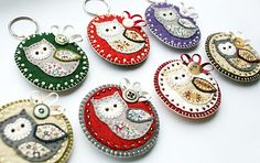 Owl brooches crafted from wool felt, fabric, ribbon, buttons and beads.