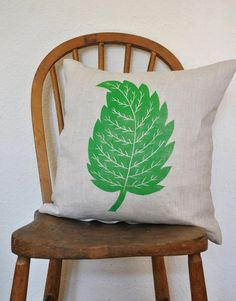 Nettle leaf. Hand printed lino print on linen cushion