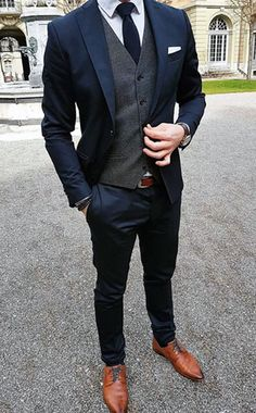 Slim Fit Single Ted Jacket Trousers With A Dark Grey Waistcoat Complete This Look Matching Navy Tie And Brown Shoes
