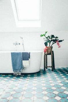 Smart and simple bathtub with blue patterned tiles