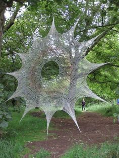 Fishing line web by Shane Waltener... http://www.weeklyweaves.blogspot.com/2012/04/over-here-over-there-over-where.html