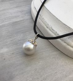A personal favorite from my Etsy shop https://www.etsy.com/listing/492142233/leather-pearl-choker-gift-idea-gift-for