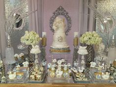 Incredible dessert table at a winter wonderland baby shower party! See more party planning ideas at CatchMyParty.com!