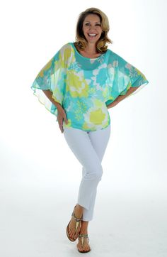 The spring colors of this dolman blouse by Ruby Rd. are sensational. As temperatures rise and cruise season rolls in, this item is a wardrobe must.
